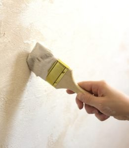 Carefully apply touch up paint to your walls and trim.