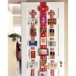 Display Christmas cards from ribbons on your doors.